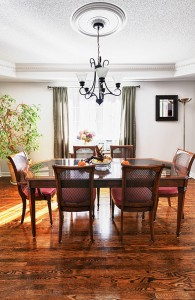 Dining room interior with wooden table and chairs in house